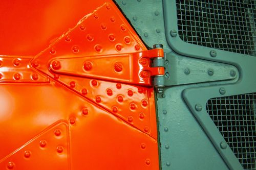 signal colour,helicopter door,rivet,screw,door hinge,lacquered,metal,graphically