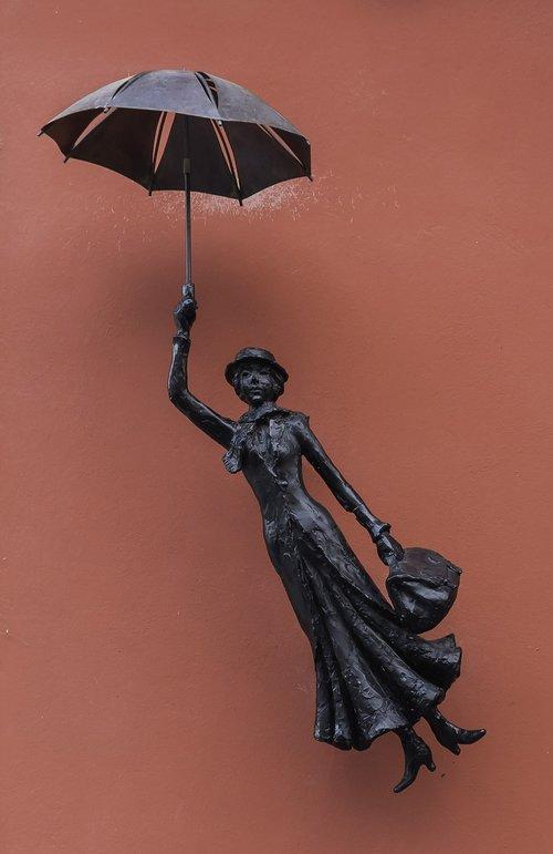 signboard  umbrella  woman