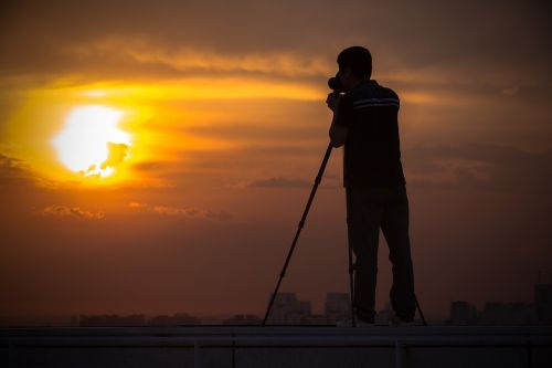 silhouette shooting sunset