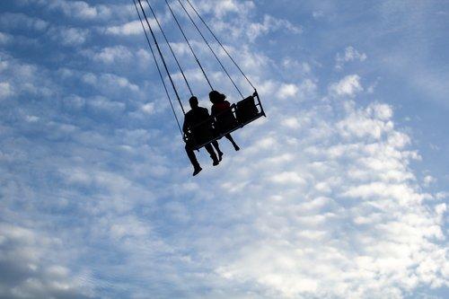 silhouette  swings  sky