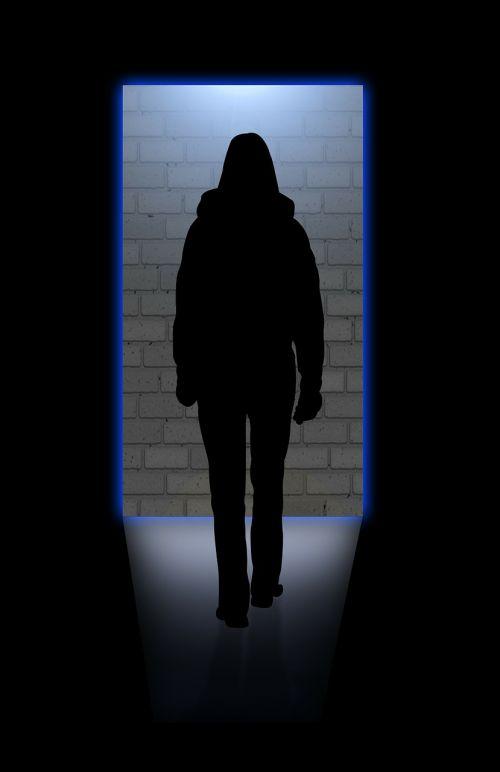 silhouette woman door