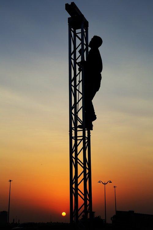 silhouette teamwork  trust  climbing