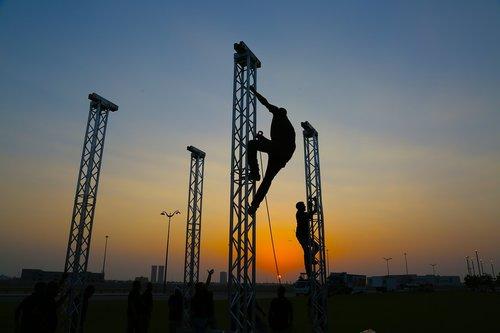 silhouette teamwork  trust  mountain