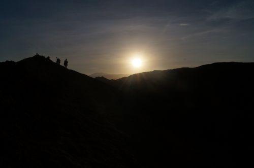 silhouettes sunset desert