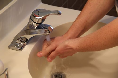 sink washing hands water