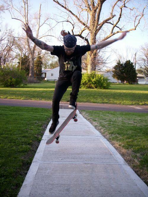 skateboarding skateboarder sidewalk