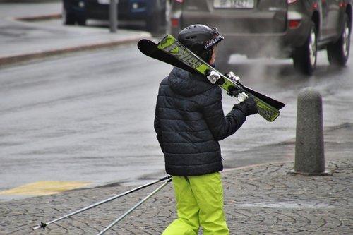skier  skis  street