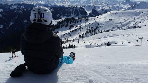 skiers ski mountains