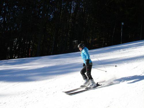 skiers ski run ski area