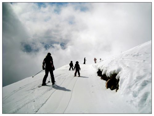 skiers skiing ski run