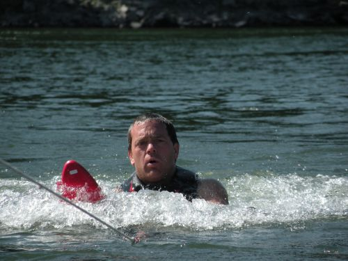 skiing male boating