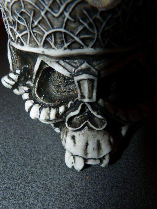 skull and crossbones gothic sculpture