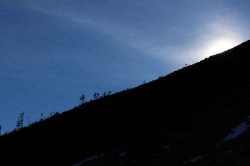sky mountainside sun