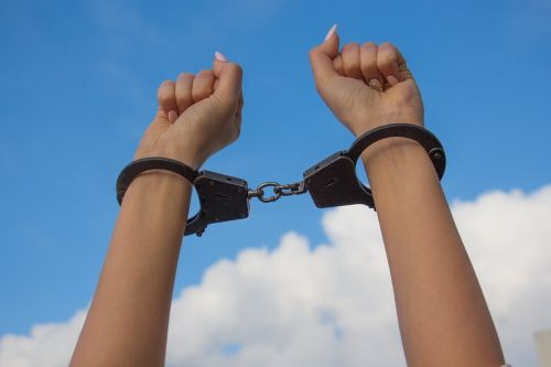 sky hands in handcuffs female hands