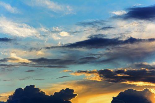 sky,clouds,sunset,evening sky,spotlight,landscape,nature,sun,blue,mood,lichtspiel,the sky,abendstimmung,atmospheric,background,atmosphere,clouds form,dark clouds