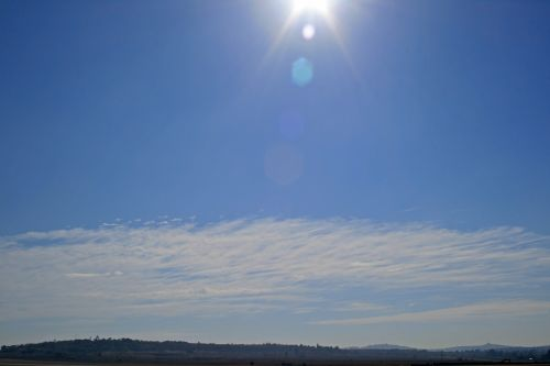 Sky With Sunbeams And Flares
