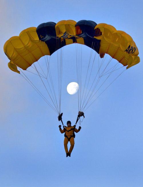 skydiver parachuting full moon