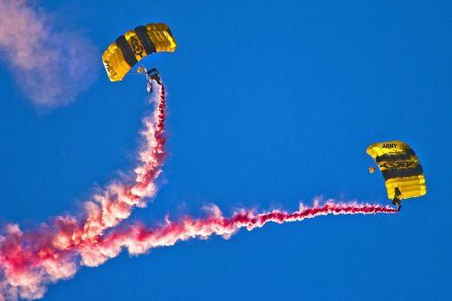 skydivers parachuting smoke