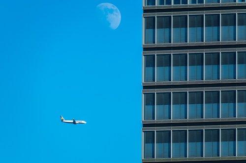 skyscraper  aircraft  moon