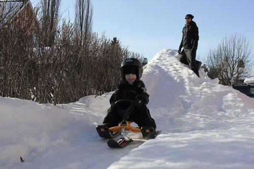 sledding  children  backe