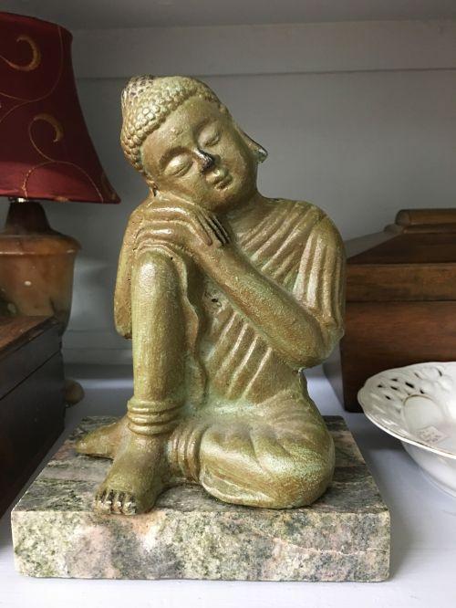 sleeping seated buddha statue