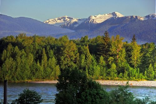 snow capped mountains rivers forest