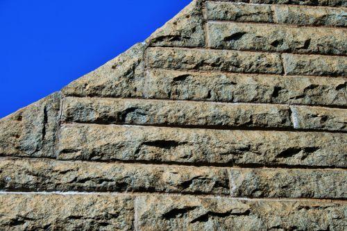 Sloped Granite Wall