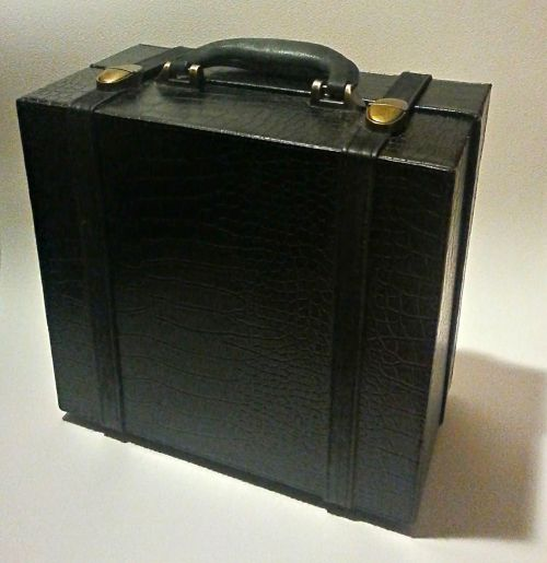 small black suitcase travel case