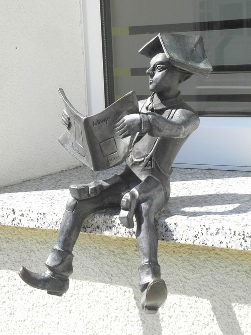 small sculpture on the window sill  calauer schuster young  reading