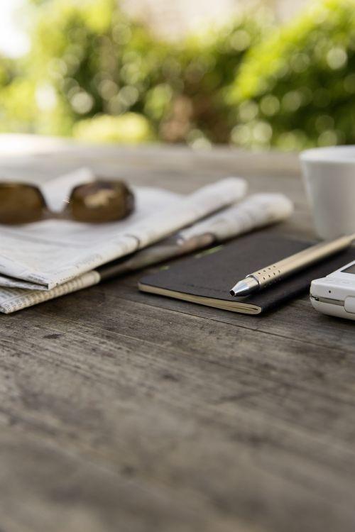 smartphone sunglasses newspaper