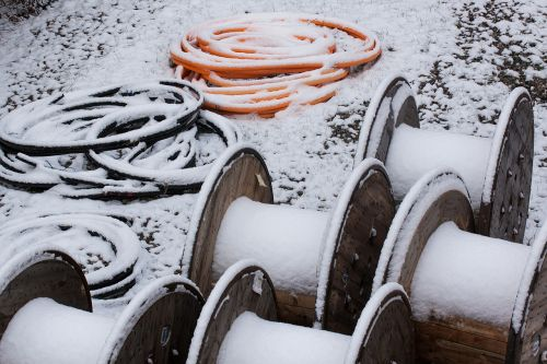 snow,new zealand,winter,white,cold,frozen,cable drums,wood,cable,black,orange,fluorescent orange,neon colors,site