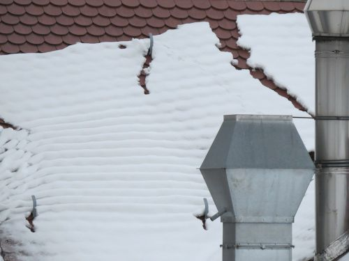 snow dachlawine roof