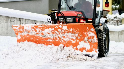 snow plowing plough tractor