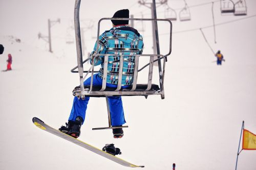 snowboarder chairlift snow