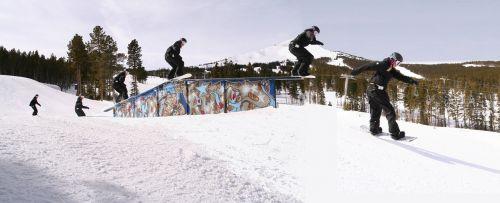 snowboarding rail-slide snowboarder