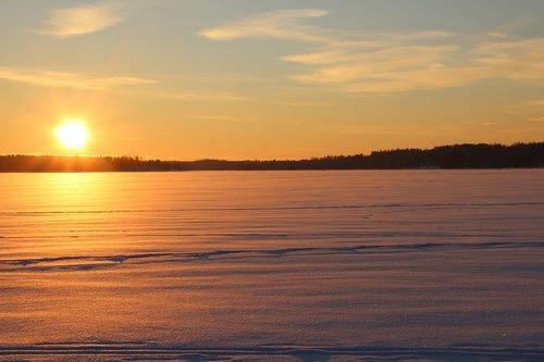 snowmobile  sunset  finnish