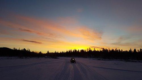 snowmobile  sunrise  snow