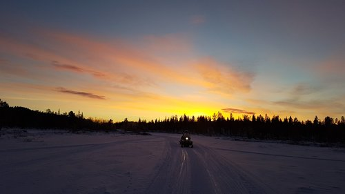 snowmobile  sunrise  sweden
