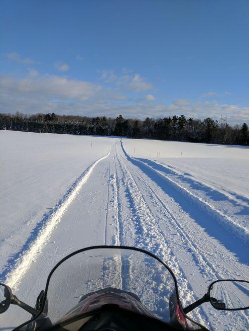 snowmobiling snowmobile sledding