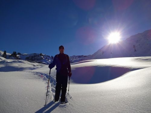 snowshoeing sun winter