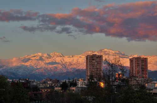 snowy mountains city sunset