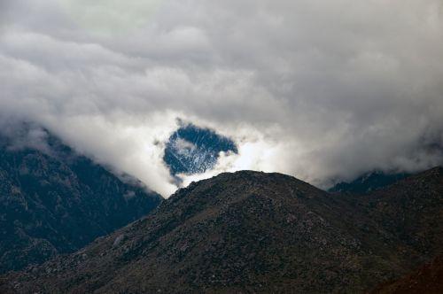 Snowy Peak Through The Clouds