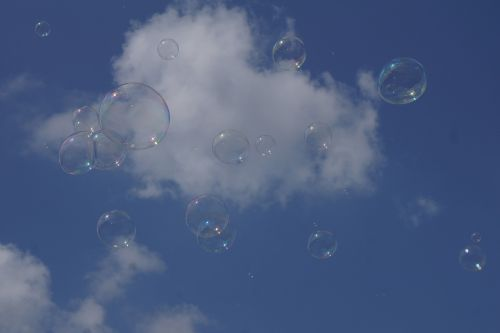 soap bubbles sky blue