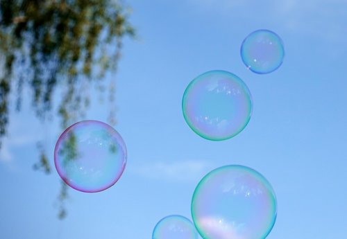 soap bubbles  colorful  flying