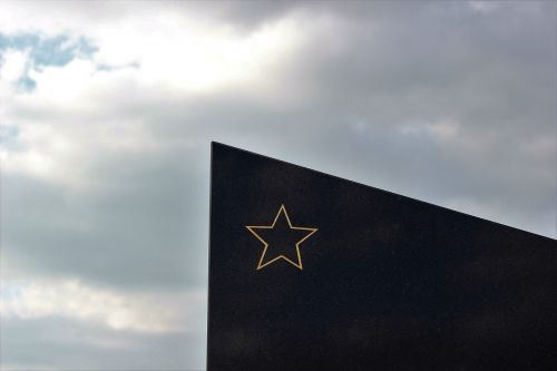 socialist monument gold star black marble