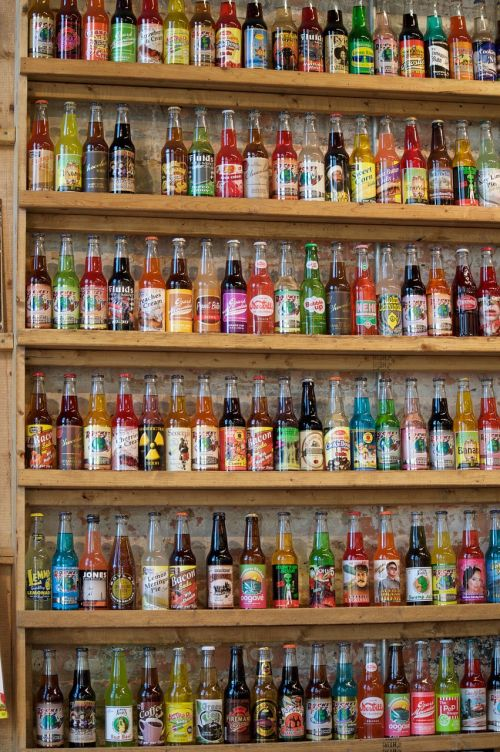 soda,pop,wall,bottles,fizzy,cola,carbonated,sodapop,beverage,drink,refreshment,shelves