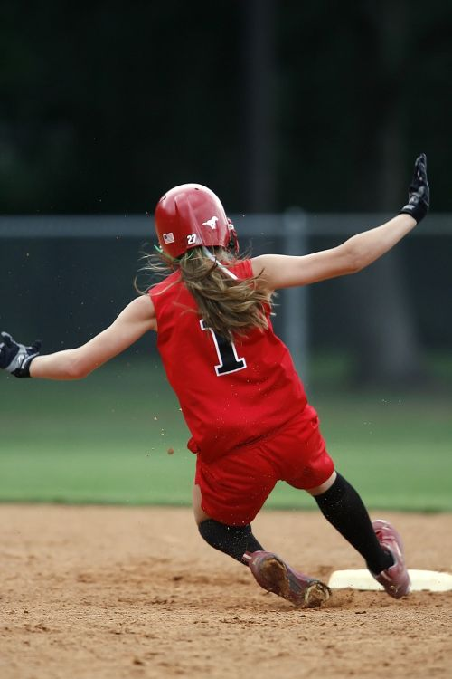 softball player sliding