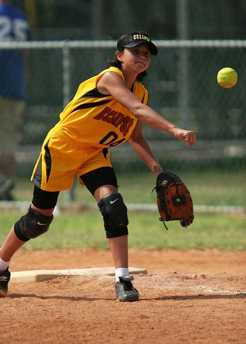 softball throwing girl