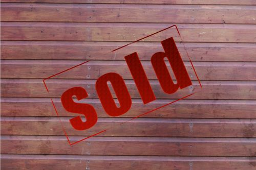 Sold Sign Wood Background
