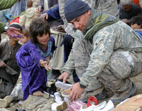 soldier help child